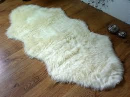 cream ivory faux fur oblong sheepskin rug 70 x 140 cm washable