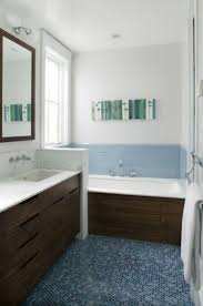 18 best blue and brown bathrooms images on pinterest bathroom bathroom small bathroom decorating ideas simple small bathroom decorating ideas with abstract wall art and mozaic glass tiles in the floor and blue