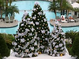 silver three christmas trees decorated with white ribbons and