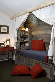 bedroom red pillows on built in bed plus canopy also built in