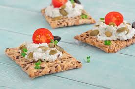 canapé made in canape made cookies with cheese cherry tomatoes and black olive