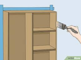 how to paint particle board cabinets how to refinish particle board cabinets with pictures
