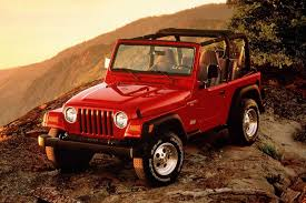 jeep sahara red 2018 jeep wrangler clings to a brand new mountain