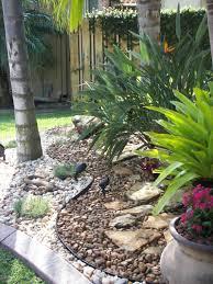 rock garden landscape great idea with plants in pots in rocks