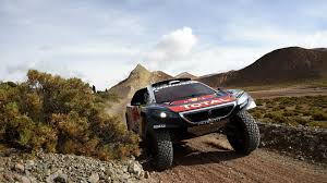 peugeot dakar 2016 sebastien loeb hints that peugeot may leave dakar after 2018 the