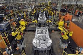 nissan finance jobs sunderland tesla motors factory assembly line with robots electric cars