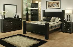 black wooden bed with headboard added by dressing table with