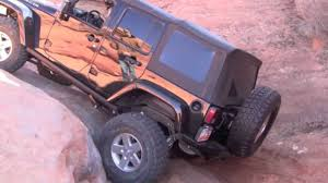 mobil jeep offroad somehow this day of mudding ends with one truck stacked on top of
