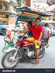 philippine tricycle manila apr 27 tricycle driver enjoys stock photo 213824275