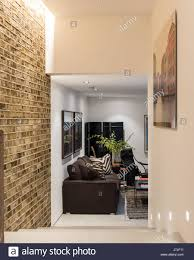 exposed brick wall in hallway with photographic print of venice
