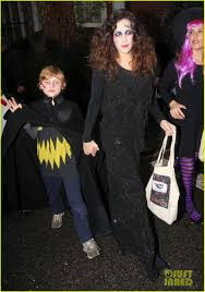 liv tyler trick or treats with son milo on halloween photo