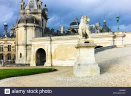 guard dog statue statue of a guard dog at the palace of chantilly stock photo