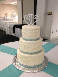 cake ribbon simple buttercream wedding cake with blue rhinestone