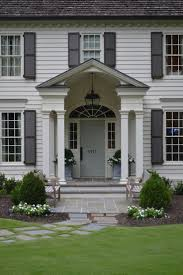 exterior colonial style design using white house with grey trim
