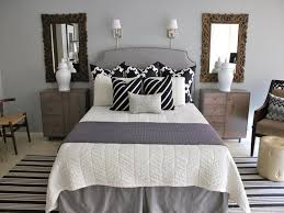 striped carpet with ornate wooden mirror for relaxing bedroom