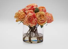 mixed orange roses in glass florals u0026 trees