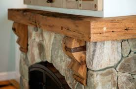 interior stone fireplace wood mantel and natural wood mantels