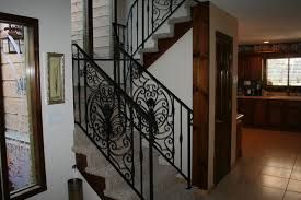 interior custom ornamental iron stair rail with custom design panels