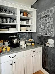 chalkboard wall plain white kitchen cabinet smooth grey countertop