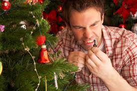 fixing christmas tree lights young man fixing christmas tree lights at home stock photo image