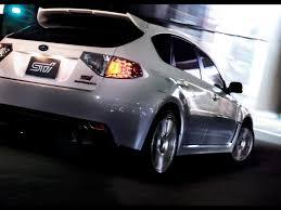 subaru wrx sport hatchback 2009 subaru impreza wrx sti a line rear angle speed 1024x768