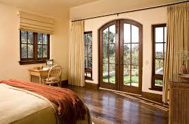wall of french doors bedroom mediterranean with wood desk wicker