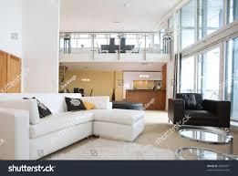 modern open plan kitchen modern openplan apartment living room foreground stock photo