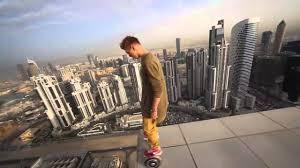 lexus hoverboard footage crazy man rides hoverboard on edge of dubai skyscraper youtube