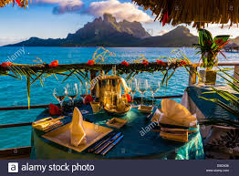 romantic private catered dinner on the deck of an overwater