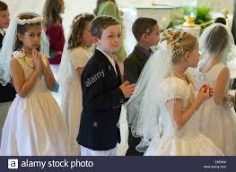 communion boys catholic boys and receiving the sacrament of holy