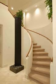 cream wall paint with white spiral staircase using wooden stepped