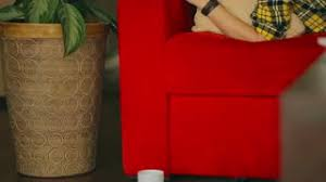 The Red Sofa Lying On The Sofa And Texting On Smartphone Steadycam Shot