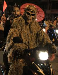 a couple dressed in costumes rides a motorbike during the u0027moto