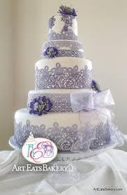 purple edible elegant romantic lace custom wedding cake design with silk flowers and organza bow jpg