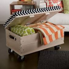 an exquisite tufted white fabric ottoman bench with wheels along