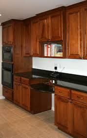 How To Clean Cherry Kitchen Cabinets by Stained Kitchen Cabinets With White Appliances How To Clean