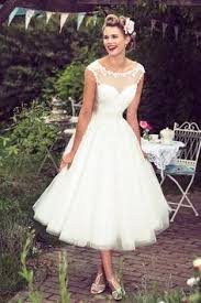 this vintage tea length a line wedding dress features strapless