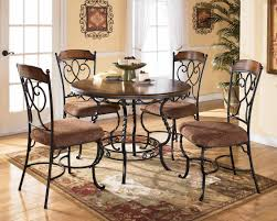 black wrought iron dining sets with varnished wooden top table and
