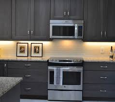 tile countertops grey stained kitchen cabinets lighting flooring