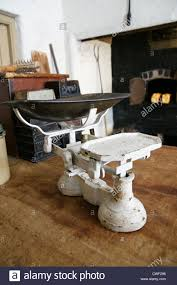 Old Fashioned Kitchen Old Fashioned Kitchen Weighing Scales In A Rustic Kitchen Stock