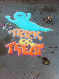 sidewalk chalk art on the driveway for halloween trick or treat