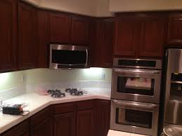 Crown Molding Ideas For Kitchen Cabinets Kitchen Brown Restaining Cabinets With Under Cabinet Lighting And