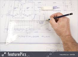 people at work architect drawing up plans for a house stock