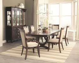 7 dining room sets coaster alyssa 7 trestle dining room set in cognac by