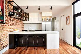 industrial kitchen and versatile family room redefine the view in gallery a curvy kitchen island adds contemporary flair to the industrial setting industrial kitchen and versatile family