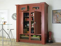 american style kitchen space with free standing pantry cabinet