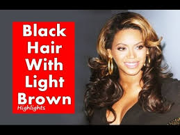 light brown hair with caramel highlights on african americans american african women black hair with light brown highlights