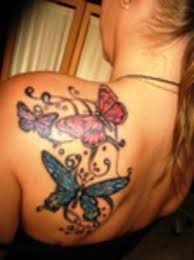 colourful butterfly on hip bone design idea