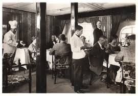 in flight the dining room of the graf zeppelin airship early