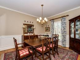 traditional dining room with chandelier u0026 wainscoting in charlotte